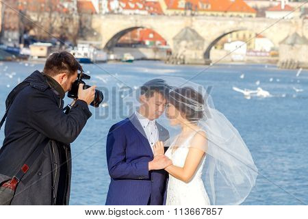 Prague. A pair of newlyweds on the banks of the Vltava.