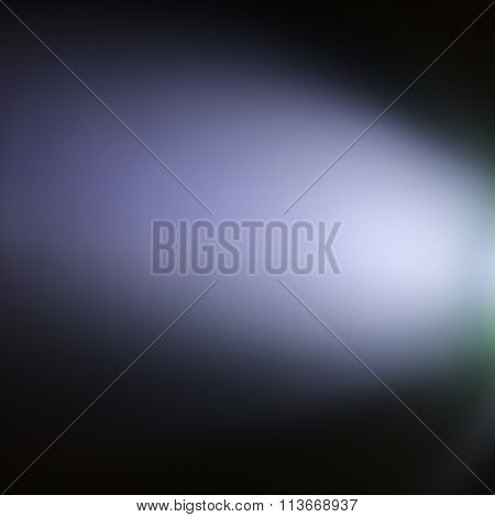 Spotlight on Blue Background