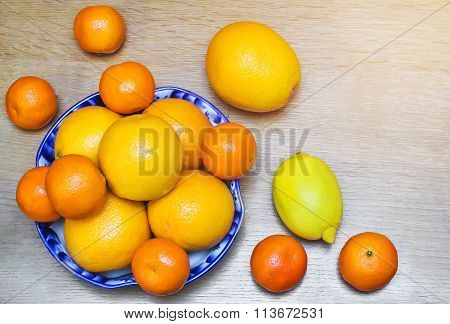 Oranges And Tangerines In A Beautiful Ceramic Vase.