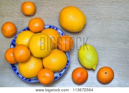 Oranges And Tangerines In A Beautiful Ceramic Vase.