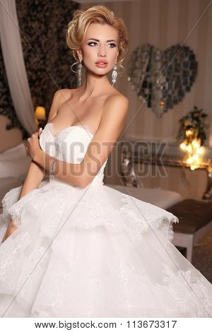 Gorgeous Woman With Blond Hair Wears Luxurious Wedding Dress And Bijou
