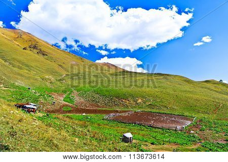 Little Farm In The Caucasus Mountains.