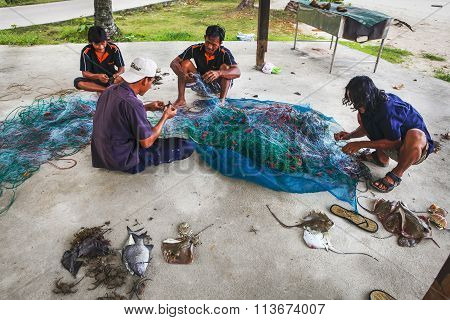 Fishermen On The Dismantled Catch