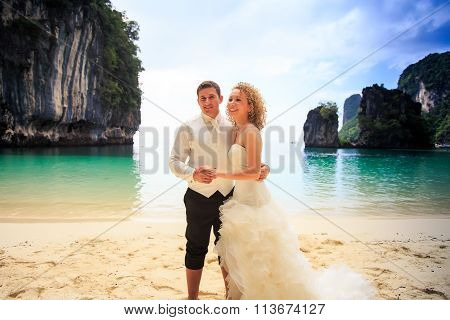 Groom Blonde Curly Bride In Fluffy Stand Join Hands On Beach
