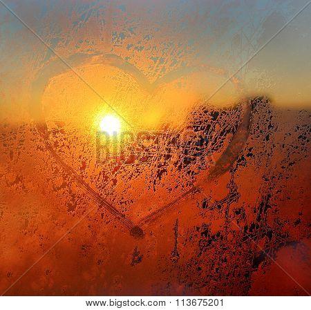Heart Drawn On The Frozen Winter Window