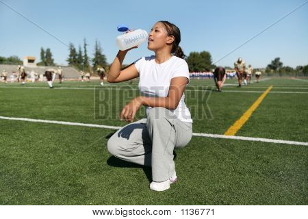 Woman Athlete Drinking