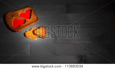The Hearts Which Are Cut Out From Rye Fried Bread On Gray Boards