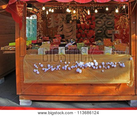 stall with dried fruits on fair in Bergamo