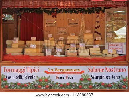 stand with many sorts of cheese at the christmas fair in Bergamo, Italy