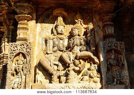 Artistic sculpture of Lord Shiva & Parvati Devi at Hoysaleswara temple at Halebidu, Karnataka
