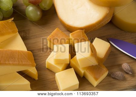 Italian Provolone On Wooden Board