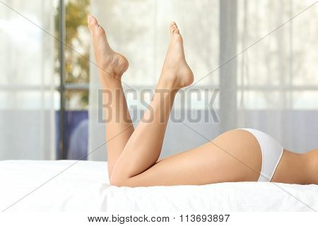 Perfect Woman Waxed Legs On A Bed