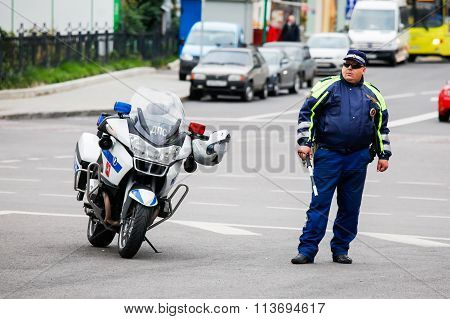 Traffic Police (DPS) Inspector Near A Motorcycle