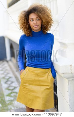 Young Girl With Afro Hairstyle In Urban Background