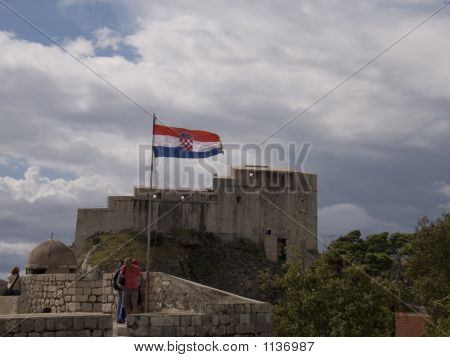 the croatian flag flying over the old town of dubrovnik