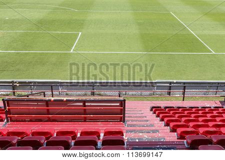 Row Of Red Chairs In Football Stadium