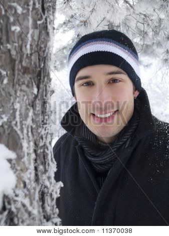 Young Man Smiling In Winter Park