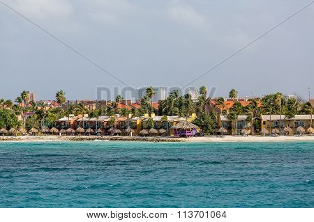 Thatched Umbrellas By Beach Condos