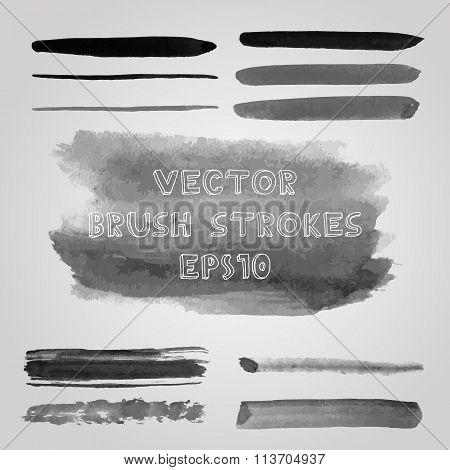 Set of grunge shades of grey watercolor brush strokes