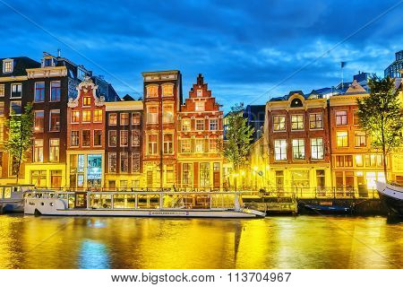 Amsterdam, Netherlands- September 16, 2015: Famous Amstel River And Night View Of Beautiful Amsterda