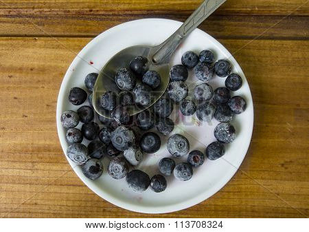 Still-life With Frozen Blueberries On Plate And Spoon
