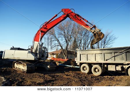 Mechanical Digger And Truck