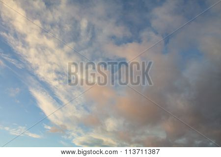 Two Levels Of Clouds On Blue Sky