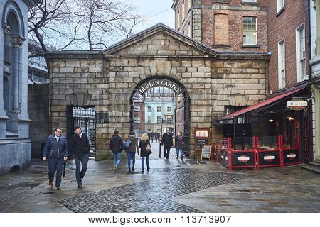DUBLIN, IRELAND - JANUARY 05: Pedestrians walking in front of Dublin Castle gates. January 05, 2016 in Dublin