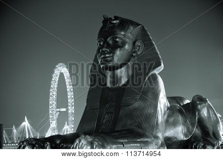 LONDON, UK - SEP 27: Sphinx statue and London Eye on September 27, 2013 in London, UK. London is the world's most visited city and the capital of UK.