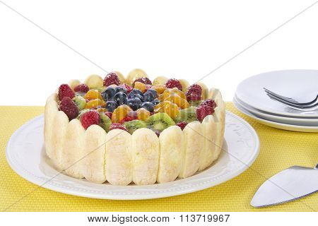 Fresh fruit tart with lady fingers cookies.