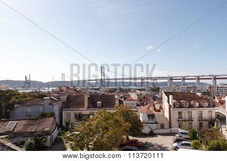 25 de Abril Bridge and view of Lisbon cityscape