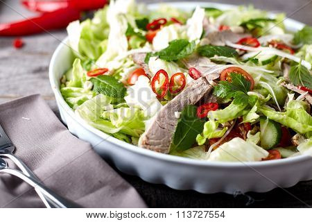 Spicy thai salad with beef and green herbs