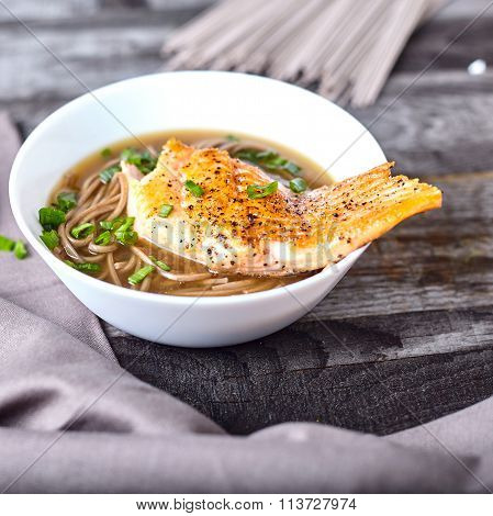 Bowl of soba noodle salmon asian soup