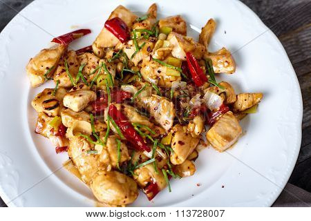 Kung Pao Chicken on wood background