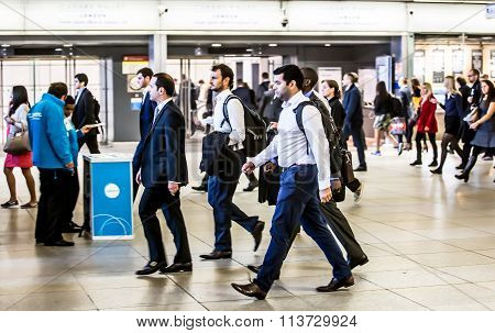 Commuters walking in the underground hall. London