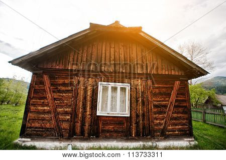 Antique Wooden House With One Window On Sunset