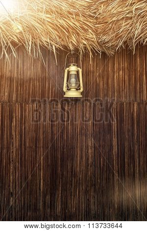 Old fashioned vintage kerosene oil lantern lamp with aged wooden wall