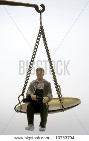 Man Sitting On Golden Weighing Scale