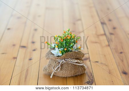 Vase Of Flowers In A Brown Bag.