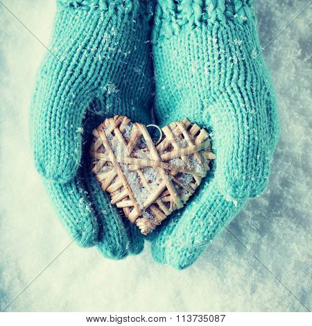 Female Hands In Teal Knitted Mittens With A Entwined Vintage Rom
