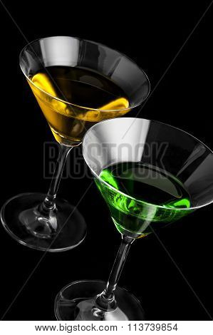 Martini glasses on black background in vertical format