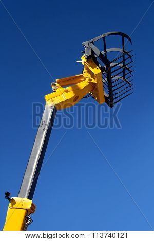 Forklift Against The Blue Sky