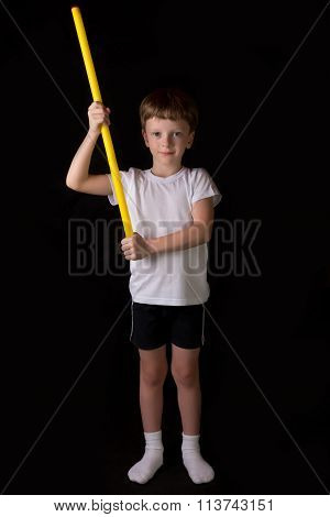 Boy Athlete Performs Exercises With Gymnastic Stick In The Gym