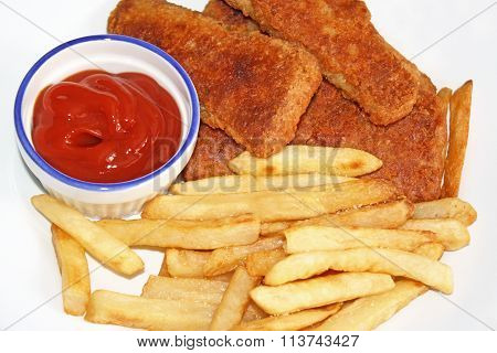 Oven baked Fish Sticks with baked french fries cooked to a golden brown.  A side of zesty ketchup fo