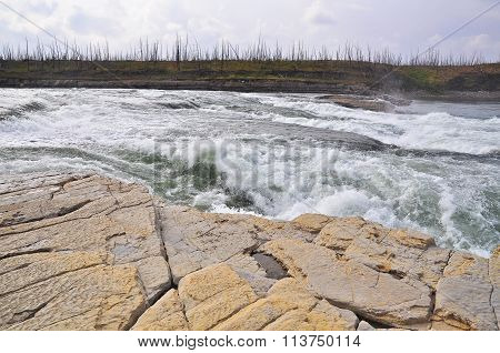 Turbulent Rapids On A Northern River.