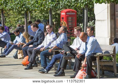 LONDON, Office workers, business People having a lunch in the park