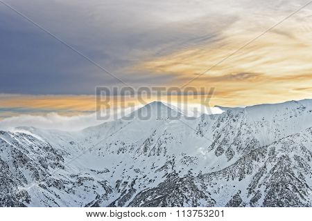 Sun And Clouds Atop Of Kasprowy Wierch Of Zakopane On Tatras In Winter