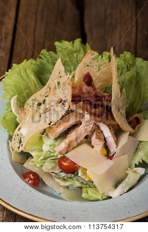 Salad with chicken breast, lettuce, parmesan and cherry tomatoes