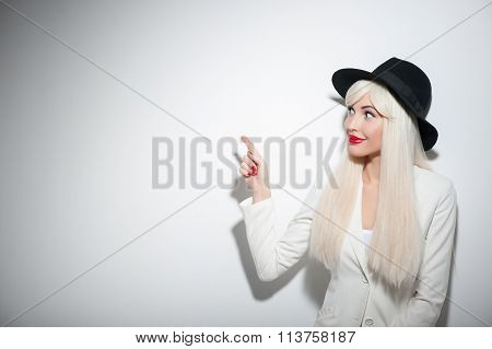 Beautiful blond girl is presenting something interesting