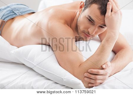 Cheerful young guy is lying with passion